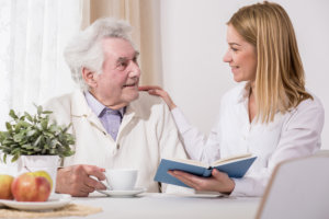 caregiver reading a story to the patient