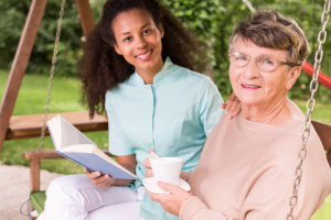 caregiver reading a story her patient